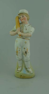 Figurine, depicts boy cricketer