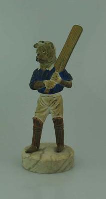 Ceramic figurine, dog in cricket attire
