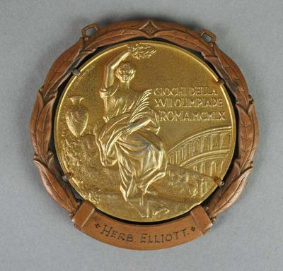 Gold medal awarded to Herb Elliott for first place in the 1500 metres event, Rome Olympic Games, 1960