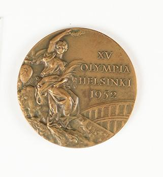 Bronze medal awarded to Vern Barberis in the men's Lightweight category at the 1952 Helsinki Olympic Games.