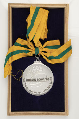 Aussie Bowl '86 medal and presentation box awarded to Carlton footballer Justin Madden, 1986