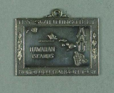 Silver medal presented to second place in Hawaiian Islands AAU 880 yards swim 30 May 1921, won by Frank Beaurepaire