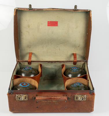 Set of four lawn bowls in leather case, used by Glyn Bosisto