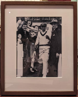 Reproduction photograph, Don Bradman heading out to bat at MCG - 1948; Photography; Framed; Photography; M16639