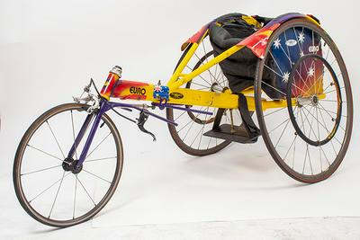 Racing wheelchair used by Lachlan Stuart Jones in  the 100m race at the Atlanta Paralympic Games, 1996