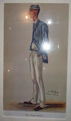 Framed, mounted colour reproduction of Sir Leslie Ward's lithograph 'The Demon Bowler' (Fred Spofforth caricature) published Vanity Fair magazine 13 July 1878