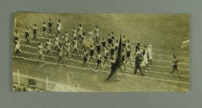 Photograph of swimming team marching at 1932 Australian Games, MCG
