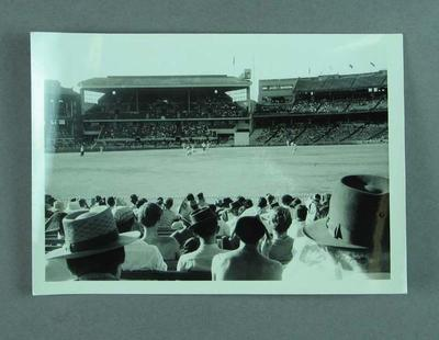 Photograph of a cricket match in progress from the crowd, MCG c1950s-60s