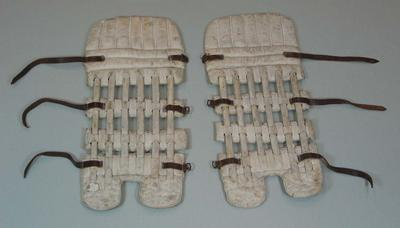Pair of batting pads used by Victor Trumper.; Sporting equipment; M16234