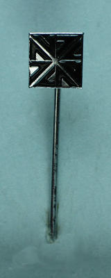 """Stick pin, small square pin with black """"NZ"""" pattern/lettering"""
