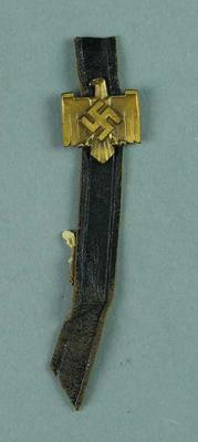 Leather strap with metal badge, collected at 1936 Olympic Games