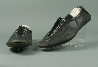 Pair of black leather running spikes, c1947