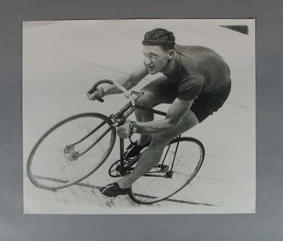 Photograph of Russell Mockridge cycling, c1950s; Photography; 1996.3234.8