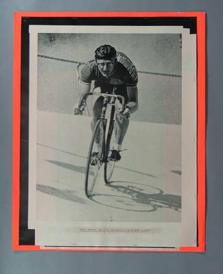 Photograph of Russell Mockridge cycling at Olympic velodrome, Melbourne c1950s