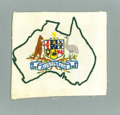 White fabric patch with embroidered Australian coat of arms