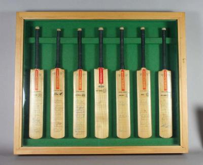 Seven autographed miniature cricket bats framed together - teams of cricket nations.