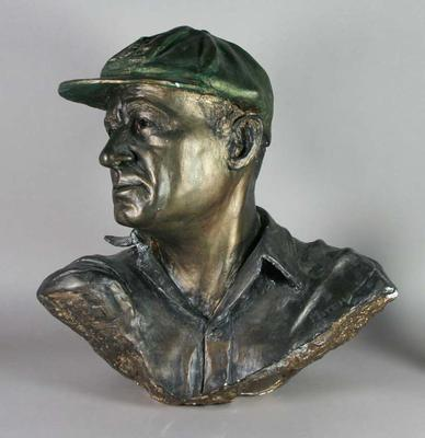 Plaster bust of Don Bradman, inscribed with his name and sculptor's  name and date.