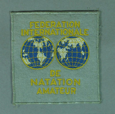 Cloth badge, Federation Internationale de Natation Amateur c1950s; Clothing or accessories; 1992.2627.82