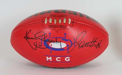 Sherrin football signed by Kevin Sheedy and James Hird, c.2005