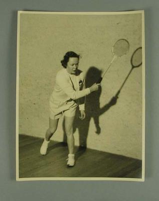 Photograph of Rae Maddern playing squash, c1953