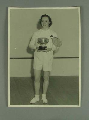 Photograph of Rae Maddern with New Zealand squash championship trophy, 1953; Photography; 2001.3758.5