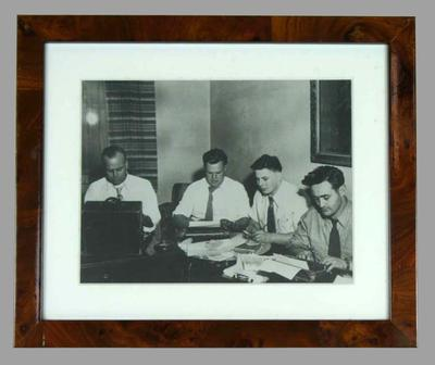 Framed black and white photograph of Ben Kerville and other sports writers/reporters circa 1954.