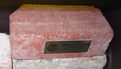 Presentation brick from the 1928 Members Pavilion building with plaque.