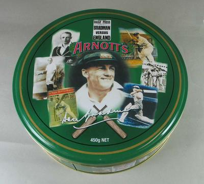 Arnott's biscuit tin, decorated with images of Don Bradman