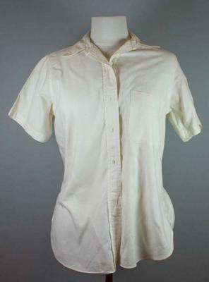 Cream short sleeved collared shirt worn by Betty Wilson