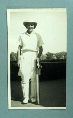 1946 Black & White full length photograph of Betty Wilson in cricket uniform ready to bat.