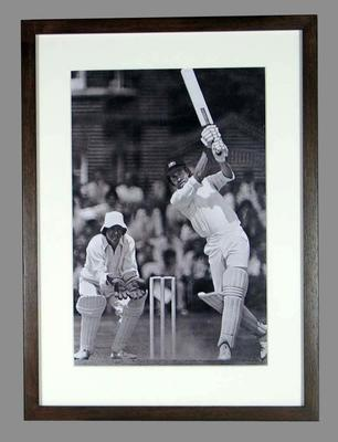 Framed black and white reproduction photograph of Greg Chappell batting