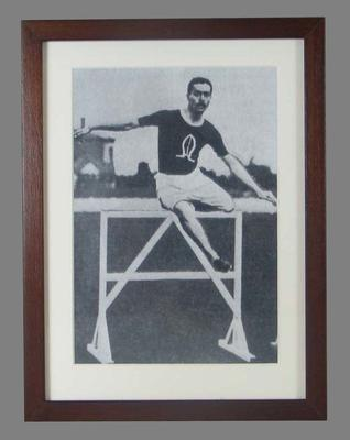 Framed reproduction of a black and white negative of Corrie Gardner competing in the 1904 Olympic Games.