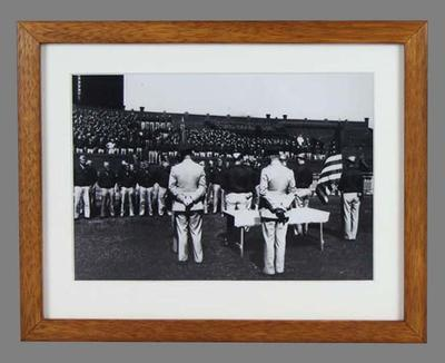 Black and white photograph, United States marines congregated on the ground of the Melbourne Cricket Ground