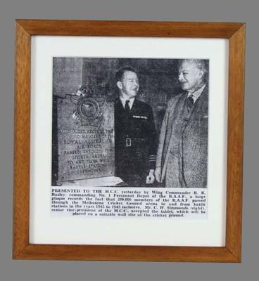 Black and white photograph, presentation of plaque from RAAF to Melbourne Cricket Ground