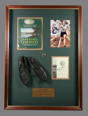 Framed, autographed running spikes worn by Betty Cuthbert at the 1956 Olympic Games in Melbourne