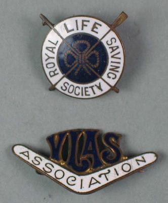 Two badges, issued by Royal Life Saving Society & Victorian Ladies Amateur Swimming Association, belonging to Lily Beaurepaire
