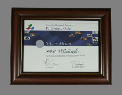 Certificate presented by the International Paralympic Committee to Bob McCullough