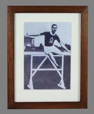 Framed facsimile of a black and white reproduction from a negative of Corrie Gardner competing in the 1904 Olympic Games