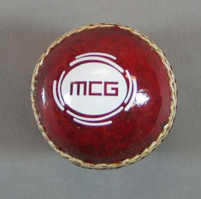 Miniature red cricket ball, MCG and Epicure logos