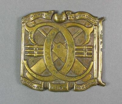 Gold coloured cricket belt buckle, 1868