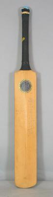 Cricket bat, unused; signed by Australian and South African Teams from the 1963/64 Test competition.