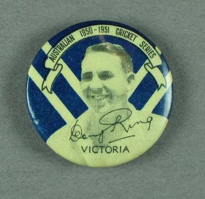 Badge, depicts Doug Ring c1950-51