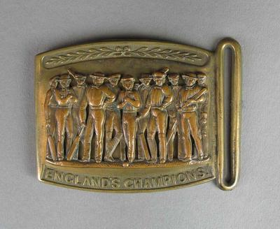 Metal belt buckle, featuring images of cricketers, 1860