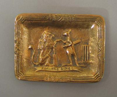 "Brass rectangular ashtray, ""FOR THE ASHES"" design"