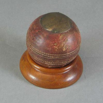 Mounted cricket ball presented to J Elliott Monfries, Lord Hawkes XI v Victoria - 13 March 1903