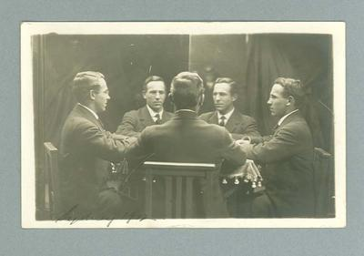 Postcard, image of five men sitting at a table