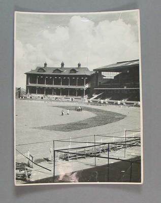 Black and white photograph of part of the MCG from the stands.