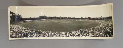 Panoramic black and white photograph of a cricket Test Match being played between England and Australia at the MCG, 1933.