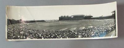 Panoramic black and white photograph of a cricket Test Match being played between England and Australia at the MCG, 1933