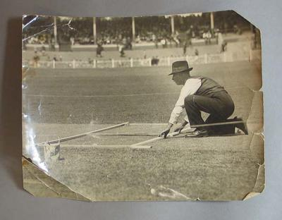Black and white photograph of Albert Luttrell marking out the Test wicket,  MCG 1929